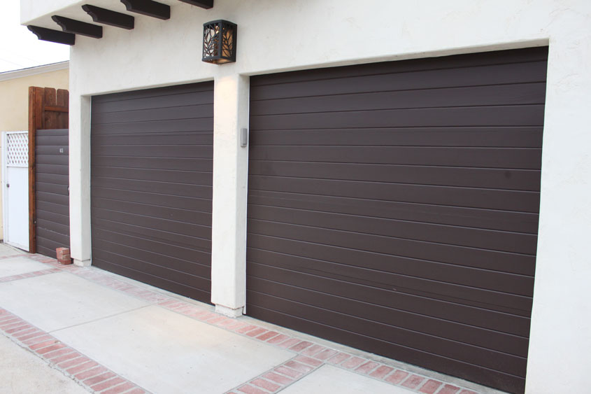 Stain grade custom wood garage doors garage doors unlimited for Stylish garage doors