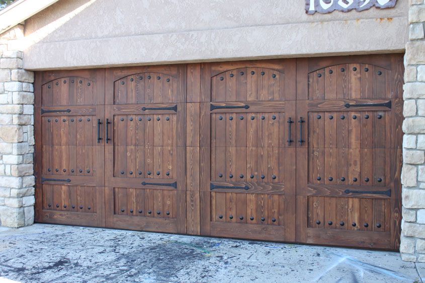 Stain grade custom wood garage doors garage doors unlimited for Wood looking garage doors