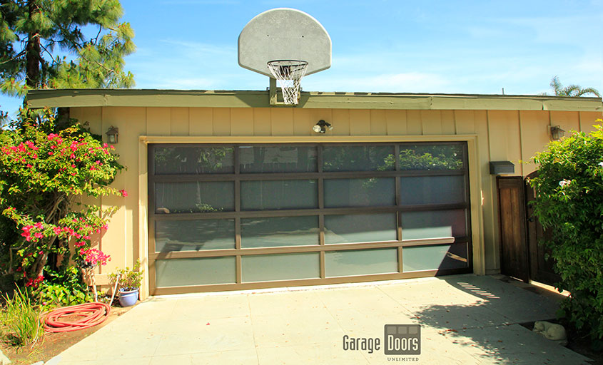 browse our gallery below and see this type of door on different styles of homes and envision your home with a glass garage door