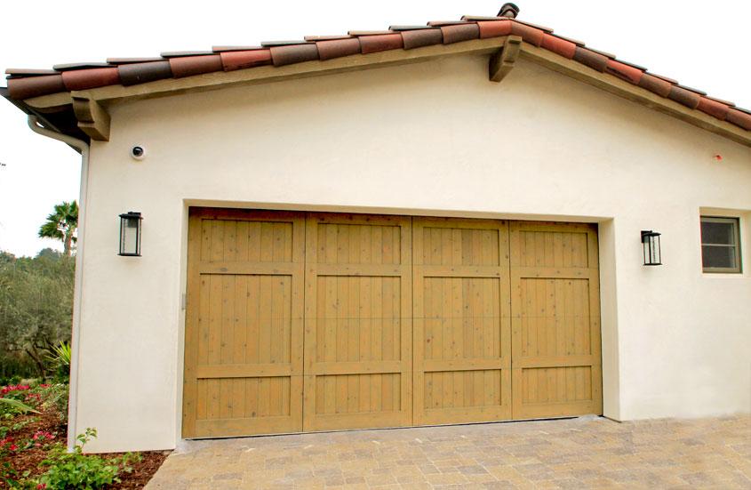 Stain grade custom wood garage doors garage doors unlimited for How to stain a garage door