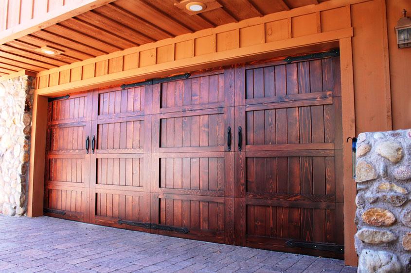 Stain grade custom wood garage doors garage doors unlimited for How to stain a wood garage door