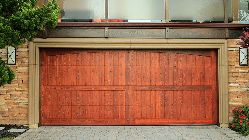 Stain grade custom wood garage doors garage doors unlimited for How to stain garage door