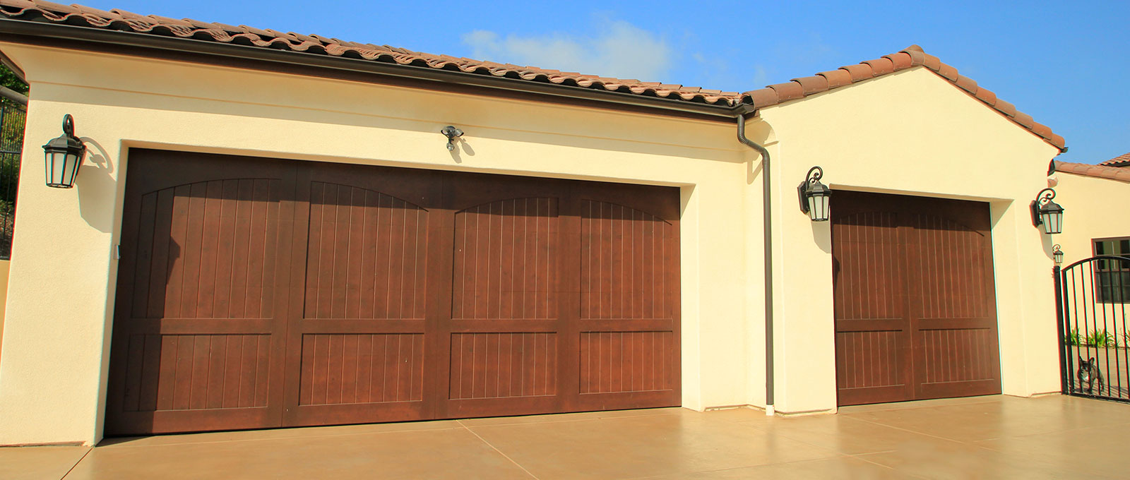 Stain grade custom wood garage doors garage doors unlimited for Stained garage doors