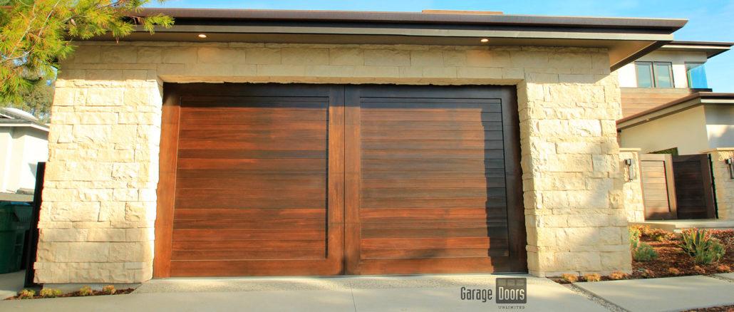 Stain grade custom wood garage doors garage doors unlimited for Hillside garage doors