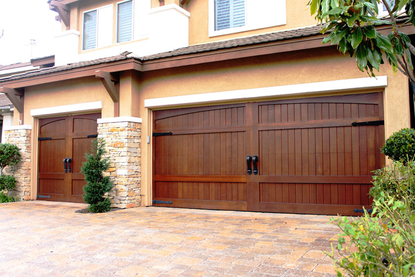 Stain grade custom wood garage doors garage doors unlimited for Garage ad stains