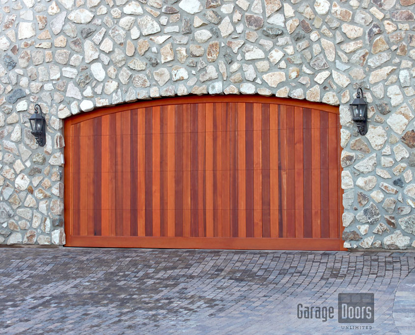 All of our stained wood doors are done through a specific process. We have professional stainers that work in conjunction with GDU to come up with the exact ... & Stain Grade Custom Wood Garage Doors   Garage Doors Unlimited